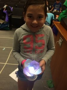 Summer camp participant with LED flower